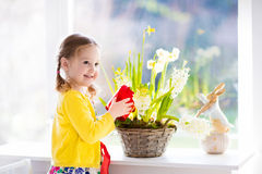 Little girl watering spring flowers Stock Photography