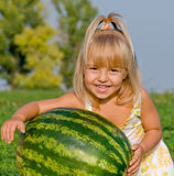 Little girl with watermelon. Little blond girl with watermelon in her hands Stock Image