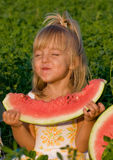 Little girl with watermelon. Little blond girl with a piece of watermelon in hands Stock Photography