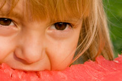 Little girl with watermelon. Little blond girl with a piece of watermelon in hands Stock Photo