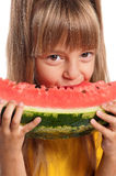 Little girl with watermelon. Little girl eating slice of watermelon on white background Stock Photo