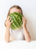 A little girl is a watermelon, croaks, laughs, humor, emotions, eat watermelon Stock Photos