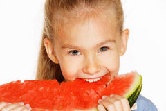 Little girl with watermelon. Cute girl in a blue dress eating red juicy watermelon Stock Photos