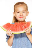 Little girl with watermelon. Cute girl in a blue dress eating red juicy watermelon Stock Image