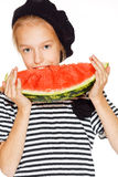 Little girl with watermelon. Cute girl eating red juicy watermelon, isolated on white Royalty Free Stock Photography