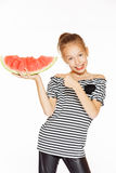 Little girl with watermelon. Cute girl eating red juicy watermelon, isolated on white Royalty Free Stock Image