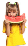 Little girl with watermelon. Little girl eating slice of watermelon isolated on white background Royalty Free Stock Photos