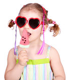 Little girl with watermelon ice cream and sunglass. Beauty little girl with watermelon ice cream and sunglasses Royalty Free Stock Photos