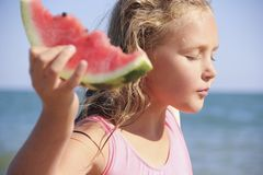 Little girl with a watermelon. The sea Stock Image