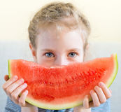 Little girl with watermelon. Little girl with slice of juicy watermelon Royalty Free Stock Image
