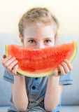 Little girl with watermelon. Little girl with slice of juicy watermelon Stock Photo