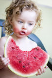 Little girl with watermelon. Little toddler eating melon, outdoor photo Stock Images