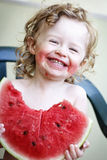 Little girl with watermelon. Little toddler eating melon, outdoor photo Royalty Free Stock Image