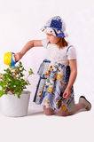A little girl waters plants Stock Photo