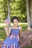 Little girl waving American flag stock images