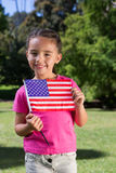 Little girl waving american flag Stock Photos