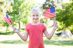 Little girl waving american flag Royalty Free Stock Image