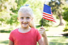 Little girl waving american flag Stock Photography