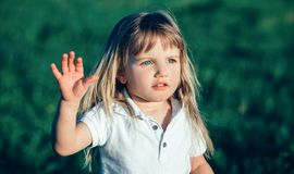 Little girl waving Stock Photography