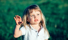 Little girl waving Stock Photos