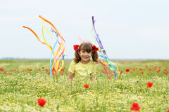 Little girl waving with colorful ribbons on wildflower mea Royalty Free Stock Photo