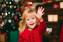 Little girl waving hand Royalty Free Stock Images