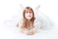 Little girl wear dress lay on the floor Royalty Free Stock Photo