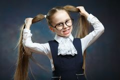 Little Girl Wear Glasses Look at Camera. Child Hold Hand on Ponytail stock photos
