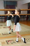 Little girl wear pointe trains in ballet class Stock Image