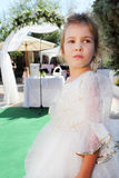 Little girl wearing in beautiful dress on holiday Royalty Free Stock Photos