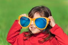 Free Little Girl Wearing Big Sunglasses Royalty Free Stock Photo - 53153055