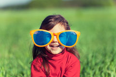 Little girl wearing big sunglasses Royalty Free Stock Image