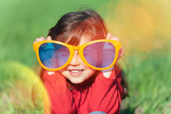Little girl wearing big sunglasses Royalty Free Stock Photo