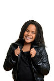 Little girl wearing black leather jacket Royalty Free Stock Images