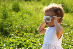 The little girl wearing the blinds-glasses Royalty Free Stock Images