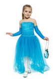 Little girl wearing blue ball dress in full length making curtsy royalty free stock photo