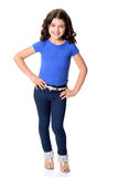 Little girl wearing blue jeans with hands on hips Stock Image