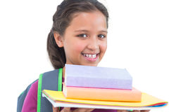Little girl wearing book bag and holding her homework Royalty Free Stock Photos