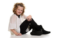 Little girl wearing boots sitting Royalty Free Stock Image