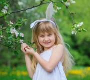 Little girl wearing bunny ears Stock Photos