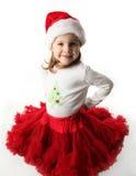 Little girl wearing Christmas santa hat and skirt stock images