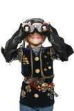 Little girl wearing costume of pirate looking away through the binoculars Stock Images