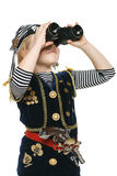 Little girl wearing costume of pirate looking away through the binoculars Stock Photos