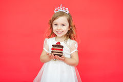 Little girl wearing crown holding a birthday cake Royalty Free Stock Photo