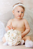 A Little girl wearing a crown and with a wedding bouquet Royalty Free Stock Photography