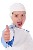 Little girl wearing a doctors uniform Stock Photography