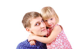 Little girl wearing dress is embracing her father. Stock Photography