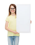 Little girl wearing eyeglasses with blank board. Vision, health, advertisement and people concept - smiling little girl wearing eyeglasses with white blank board royalty free stock photos