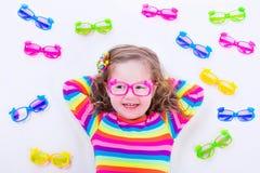Little girl wearing eyeglasses Stock Images