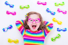 Little girl wearing eyeglasses Stock Images